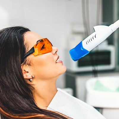 Woman receiving teeth whitening