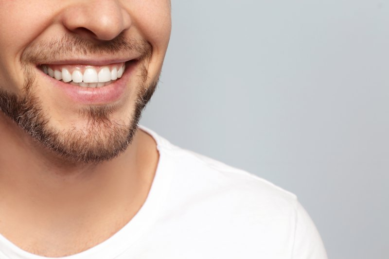 Man smiling after cosmetic dentistry